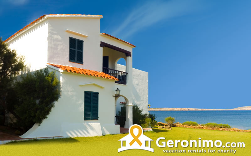 white beach house with blue sky