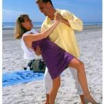 happy couple dancing on beach