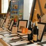 guitar, wine bottle and vacations all up for bid at silent auction event